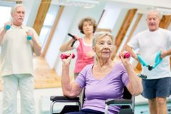 Old woman and seniors doing dumbbell training stock images