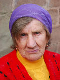 Old woman with a serious look Stock Photography