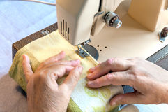 old woman at the sewing machine Royalty Free Stock Photography