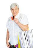 Old woman with shopping bags and credit card. Stock Photos