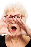 An old woman is shouting/ calling. Royalty Free Stock Photography