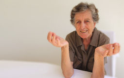 An old woman showing that she does not know what to do Stock Images
