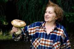Old Woman showing her trophy Royalty Free Stock Photography