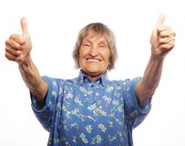 Old woman showing ok sign on a white background Stock Photography