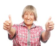 Old woman showing ok sign on a white background Royalty Free Stock Photography