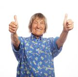 Old woman showing ok sign on a white background Stock Photos