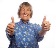 Old woman showing ok sign on a white background Royalty Free Stock Image