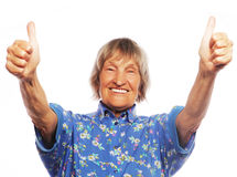Old woman showing ok sign on a white background Royalty Free Stock Images