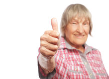 Old woman showing ok sign on a white background Royalty Free Stock Photos