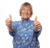 Old woman showing ok sign on a white background Stock Image