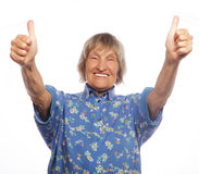 Old woman showing ok sign on a white background Stock Images