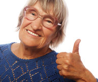 Old woman showing ok sign on a white background Stock Photo