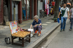 The old woman by the side of the road selling gourd Royalty Free Stock Images