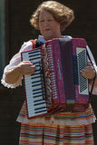 Old woman singer at accordion from Poland, in traditional costum Stock Photography