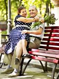 Old woman sit in hand of senior man. Stock Photo