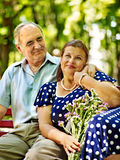 Old woman sit in hand of senior man. Stock Images