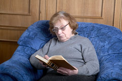The old woman sits in an armchair Royalty Free Stock Images