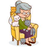 Old woman sitting in armchair with cats Stock Images