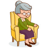 Old woman sitting in armchair Stock Images