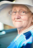 Old woman sitting in automobile Stock Photography