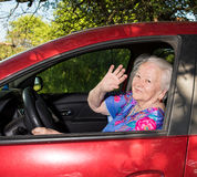 Old woman sitting inside the car Stock Photography