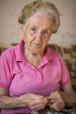 Old woman sitting and knitting. Hobby. Stock Photos