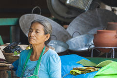 Old woman sitting. Old lady sitting, with sad expression on her face, in Ataco, El Salvador, Central America Stock Photo