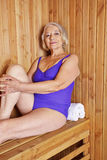 Old woman sitting in sauna Royalty Free Stock Image
