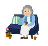 Old woman sitting on a sofa. Royalty Free Stock Images
