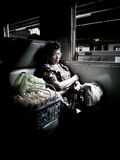 Old woman sleep in a bench of a train. BANGKOK - JANUARY 10:  A old woman sleep in a bench of a train on January 10, 2012 in Bangkok, Thailand Stock Images