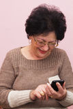 Old Woman and Smart Phone. Royalty Free Stock Photography