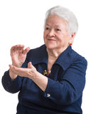Old woman smiling and applauding Stock Photography