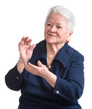 Old woman smiling and applauding Stock Photos