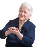 Old woman smiling and applauding Royalty Free Stock Image