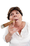 Old woman smoking a cigar Stock Images