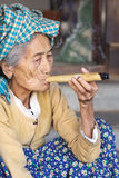 Old woman is smoking a self-made cigar, Myanmar Royalty Free Stock Photo