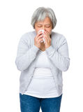 Old woman sneeze Royalty Free Stock Image
