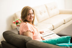 Old woman spending time in the living room Royalty Free Stock Photography