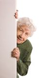 Old woman spies Stock Image