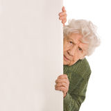 The old woman spies isolated Royalty Free Stock Photos