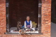 Old woman spinning wool Stock Photography
