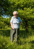 Old woman standing with a cane Stock Images