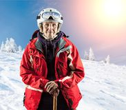 Old woman standing on snow holiday in mountains Royalty Free Stock Photography