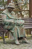 Old woman statue. Closeup with old woman statue, sitting on a bench Stock Image