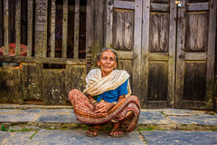 Old woman in the street of Bandipur, Nepal. BANDIPUR, NEPAL - OCTOBER 22, 2015 :  Old woman begs in the street of Bandipur Stock Photos