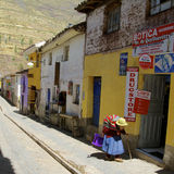 Old woman in street of peruvian village Royalty Free Stock Images