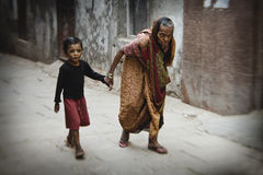 Old woman in streets of Varanasi Stock Photography