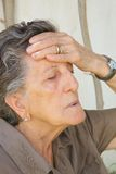 An old woman with a strong headache Stock Image