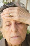 An old woman with a strong headache Stock Photography