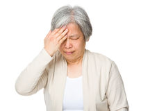 Old woman suffer from headache Royalty Free Stock Photography